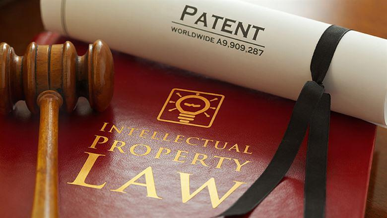 Intellectual Property Law book, patent, and gavel