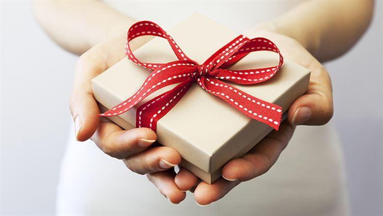 hands holding out a gift box