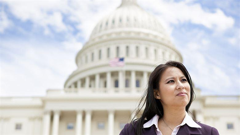 businesswoman standing in front of The U.S. Capitol
